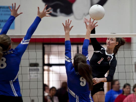 Angela Grieve (right) of South Fork High School goes for a kill over Madison Campbell (center) and Julie Tanner and  of Barron Collier High School during the 2016 FHSAA 7A Volleyball State Semifinals in Tropical Farms on Saturday, Nov. 5, 2016.