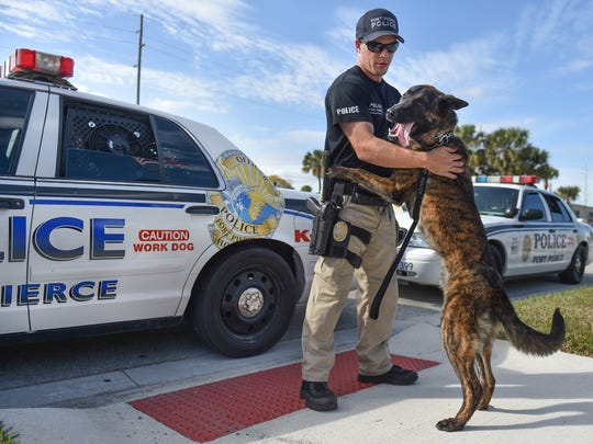 "Fort Pierce Police Officer Albert Eckrode with his new K-9, Tucker, on Thursday, Feb. 1, 2018, at the Fort Pierce Police Department. ""I love it,"" Eckrode said about joining the K-9 unit. ""It's definitely a respected unit all around, not just our agency, but countywide, statewide. It's very respected and it's a very good unit to be in."""