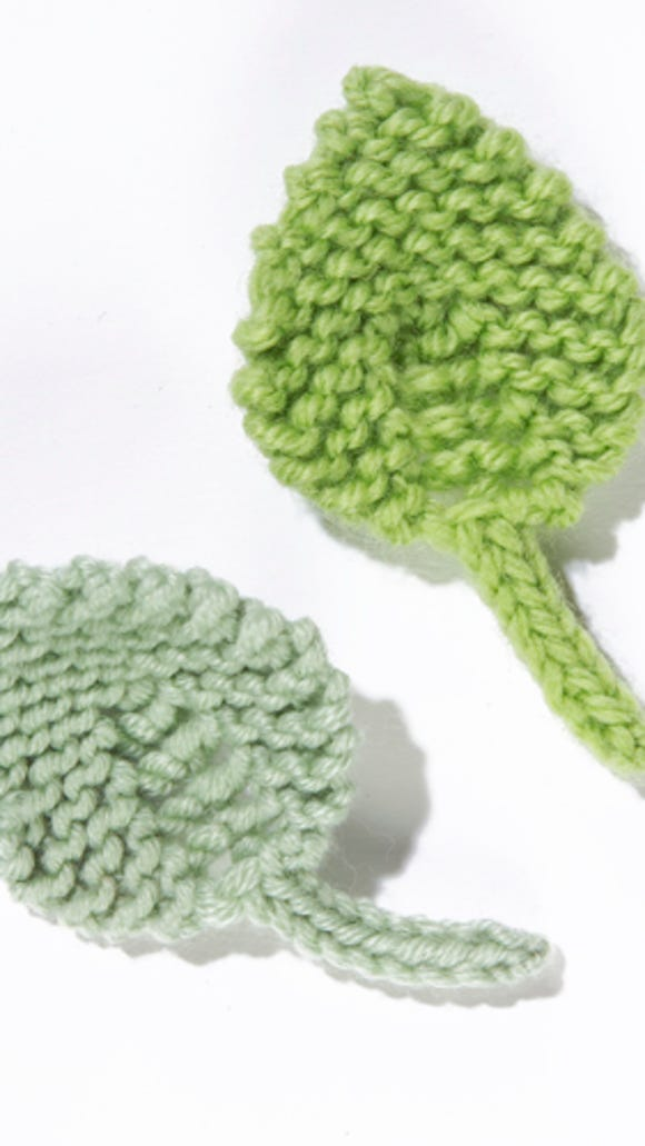 There is a free pattern on the Lion Brand Yarns site for you to make these leaves. They're great to decorate a yarn bombing.