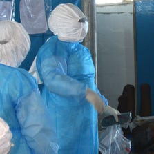 Medical workers of the John Fitzgerald Kennedy hospital of Monrovia wearing a protective suit work at the high-risk area of the hospital, the surgical section where Ebola patients are being treated, on September 3, 2014. Nurses at Liberia's largest hospital went on strike on September 1, 2014, demanding better pay and equipment to protect them against a deadly Ebola epidemic which has killed hundreds in the west African nation.