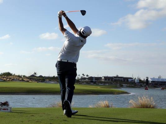 Hideki Matsuyama, of Japan, tees off from the 18th hole during the final round at the Hero World Challenge golf tournament, Sunday, Dec. 4, 2016, in Nassau, Bahamas. Matsuyama won the tournament. (AP Photo/Lynne Sladky)