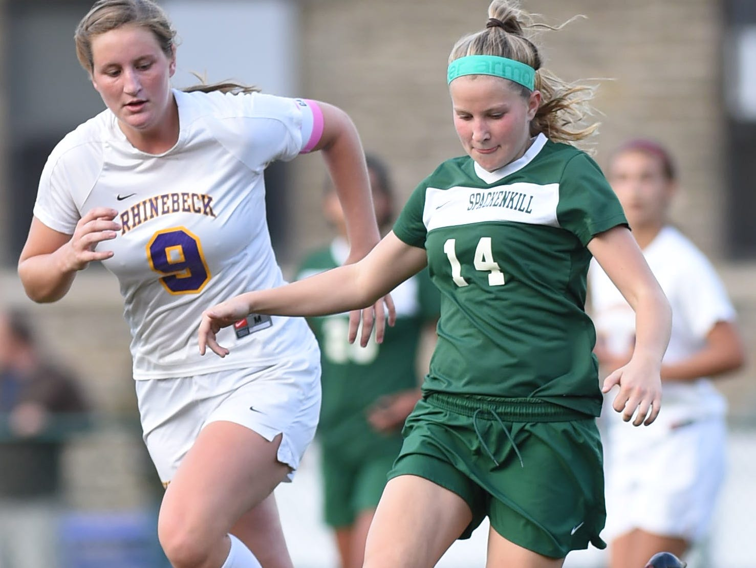 Spackenkill's Katherine Lillis keeps control of the ball ahead of Rhinebeck's Natalie Hutchins during Wednesday's game in Rhinebeck.