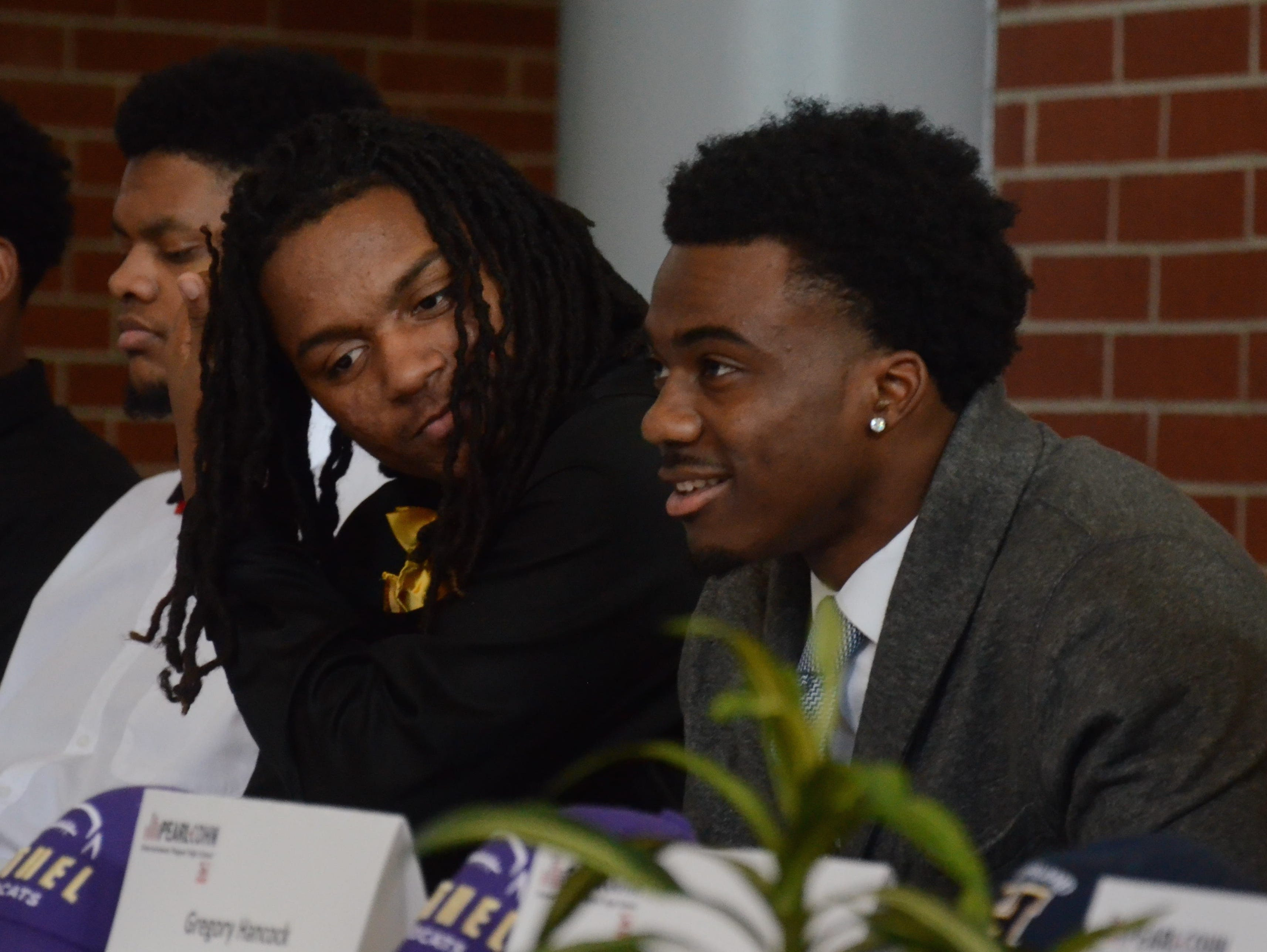 Pearl-Cohn senior Jimmy Ferrell (left) and Rontavius Groves (right) look on before signing letters of intent to play football at Alabama State and North Carolina, respectively.