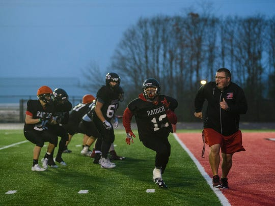 Southridge Head Coach Scott Buening (right) runs a two-point conversion drill with the football team during an evening practice at Southridge High School in Huntingburg, Ind., Wednesday, Nov. 15, 2017. The team will face No.2 Indianapolis Scecina in the Class 2A semi-state game on Saturday at 1 p.m. CST at Indianapolis Tech.