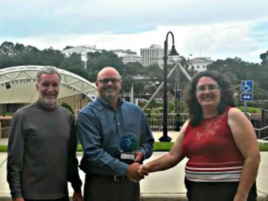 Kim Ross, President of ReThink Energy FLorida, giving