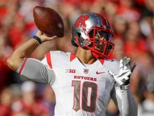 Rutgers quarterback Gary Nova throws a pass in the first half before he suffered a knee injury, the extent of which remains unknown. (AP)