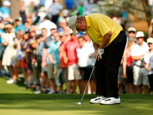 Golfing great Jack Nicklaus of the U.S. putts on the seventh green during the par 3 event held ahead of the 2015 Masters at Augusta National Golf Course in Augusta