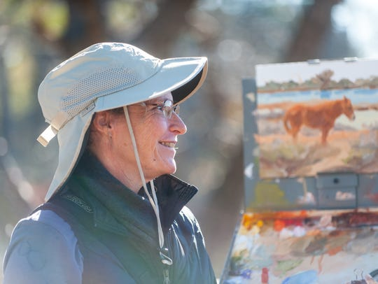Karen McLain takes in the landscape of Assateague on