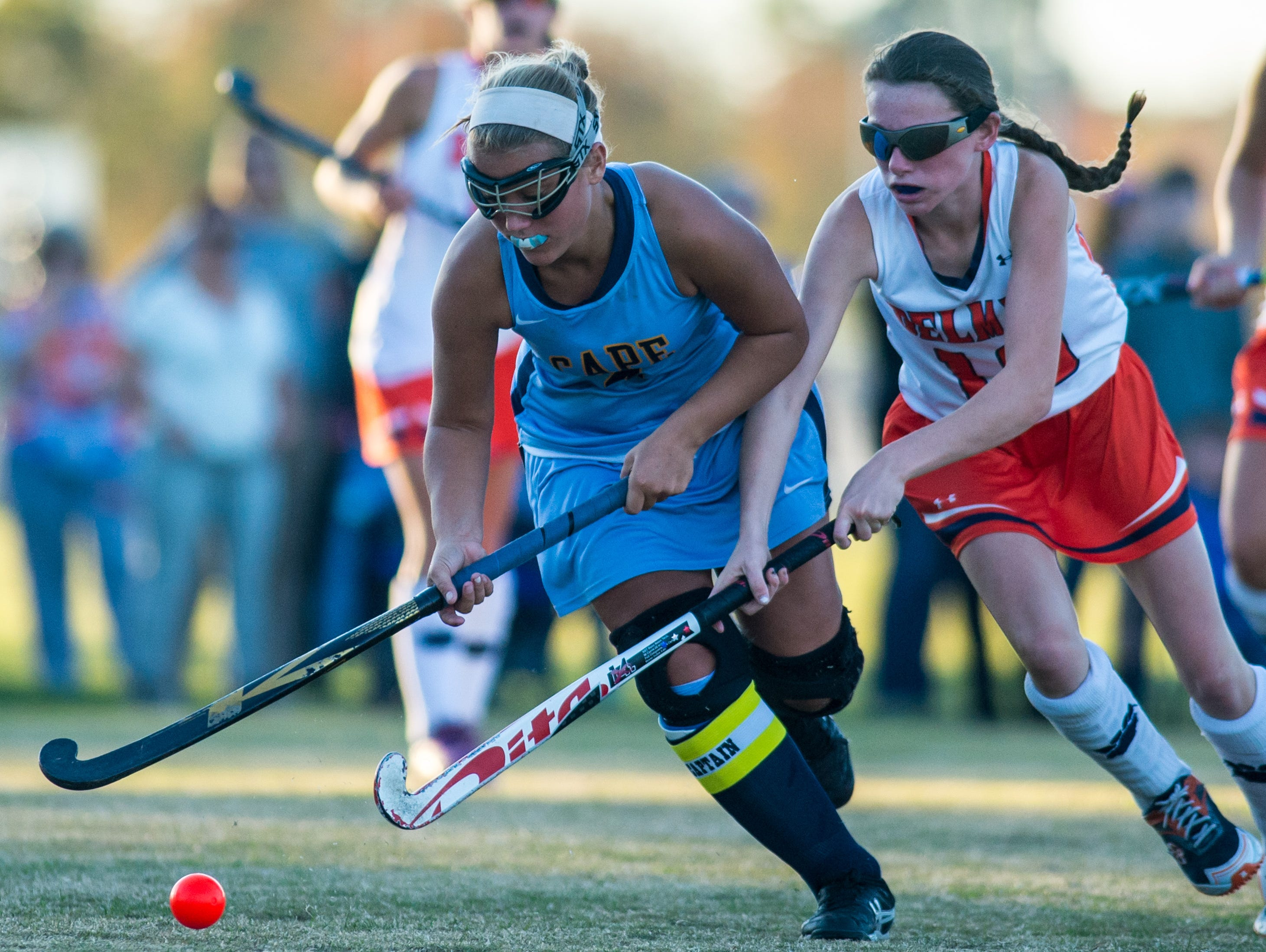 Cape Henlopen attack Sydney Ostroski (4) and Delmar midfield Nancy Harris (10) chase a ball on Tuesday afternoon at Delmar High School.