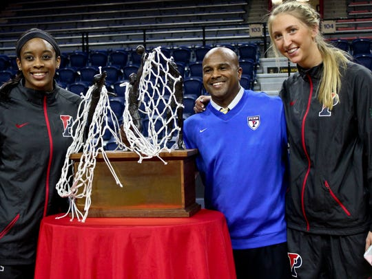 Chris Day, center, and Penn players Michelle Nwokedi,