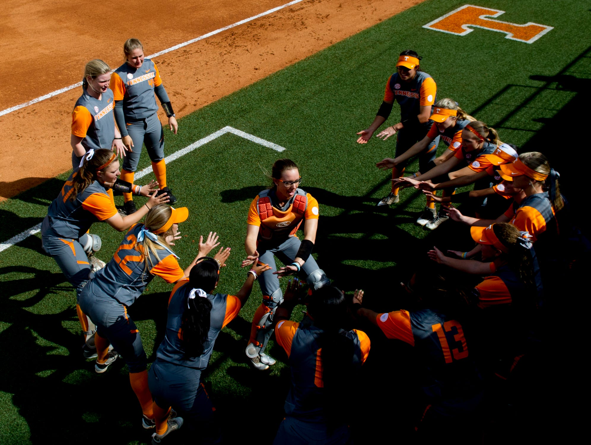 Tennessee's Scarlet McSwain (3) and the other softball players haven't spent any time talking about the team's 16-game winning streak.