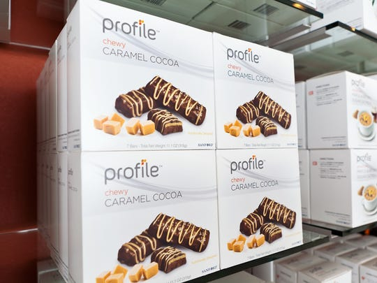 A photo of Profile by Sanford food on the shelves, in this case a caramel cocoa meal replacement bar.