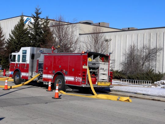 A Sheboygan fire truck is parked outside the Gateway