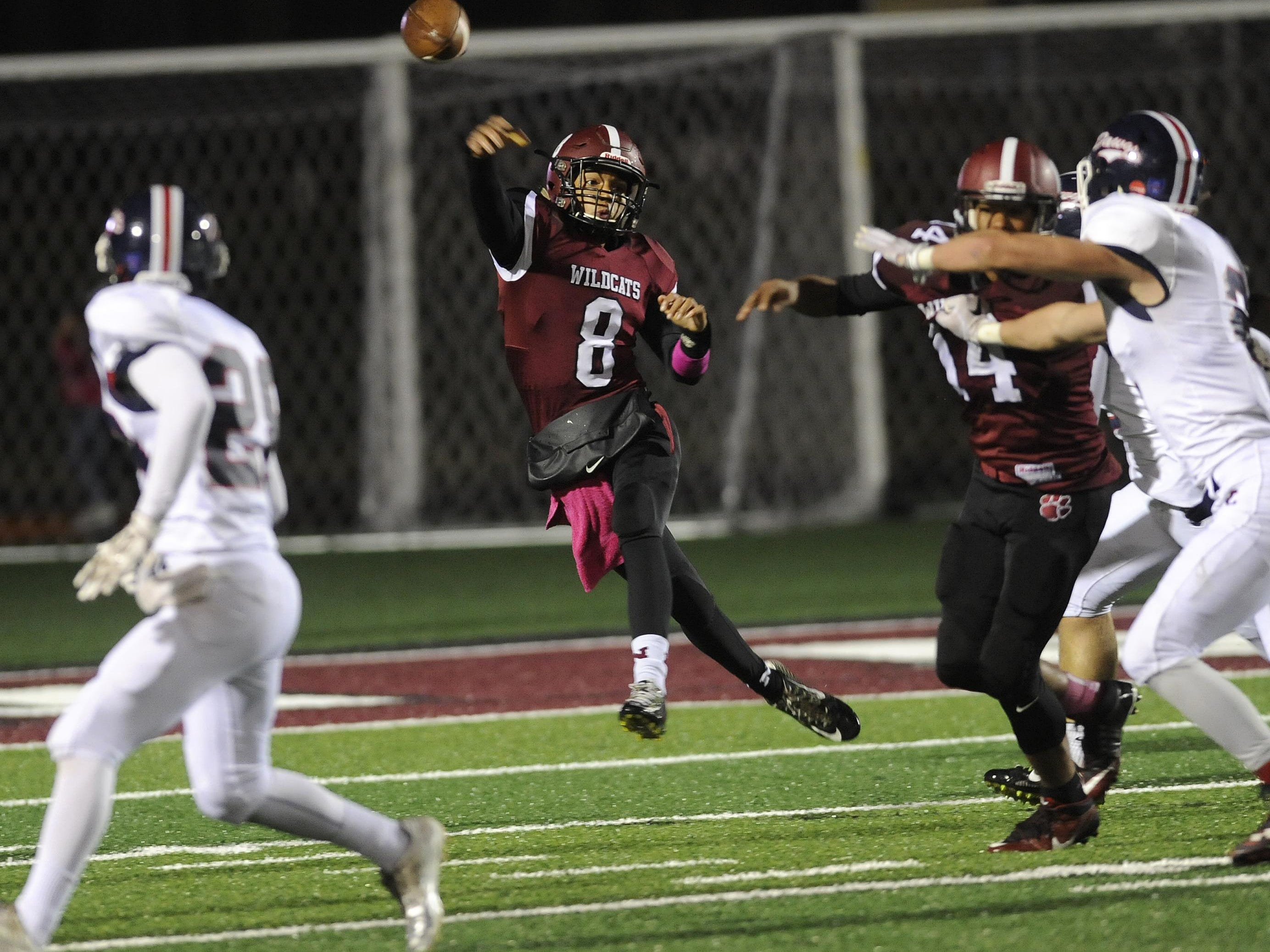 Newark quarterback Ty Scott passes the ball downfield as D'ante Woods blocks for him Friday against Grove City at White Field.