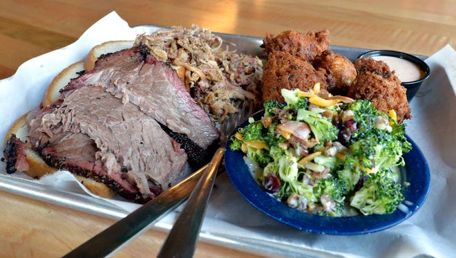 Kid Brother Sampler with brisket, pulled pork, hush puppies and broccoli salad from Martin's BBQ Joint, Friday, Aug. 04, 2017 in Louisville Ky. (Timothy D. Easley/Special to the C-J)