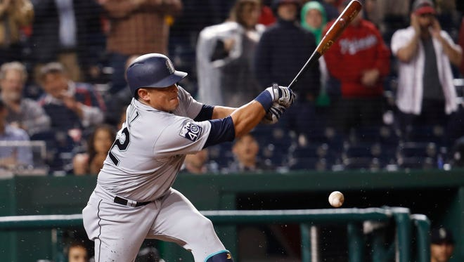 Seattle Mariners Carlos Ruiz hits the ball during the ninth inning of Tuesday's game against the Washington Nationals in Washington.