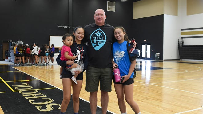 Haggan-NexGen U18 and U14 assistant coach Chris Shepherd with his nieces from left; Maemi Rabago, 2, Minami Rabago, 14, and his daughter Tylee Shepherd, 14, after a team practice at the Tiyan High School Gym on June 22, 2017.