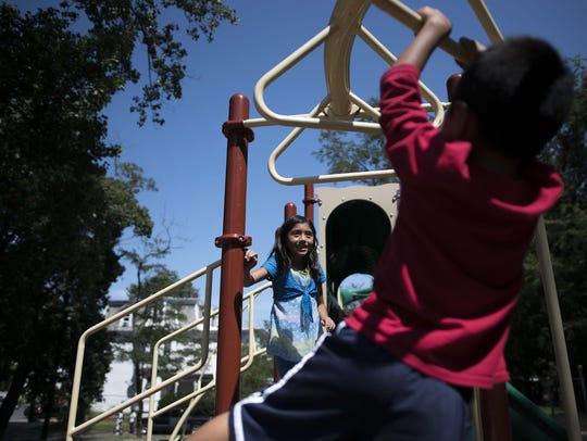 Karen Rodriguez, 8, watches her brother Eric Rodriguez,