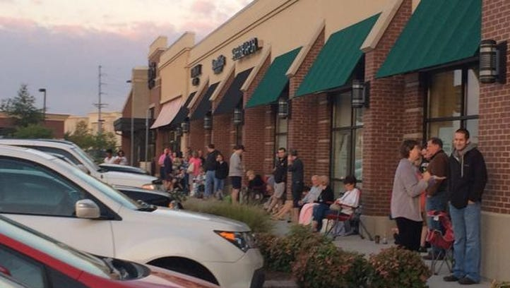 Verizon in Turkey Creek opened its doors to a line of people waiting to buy the iPhone 6.