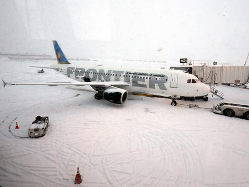 A Frontier airplane waits for passengers at O'Hare International Airport in Chicago on Thursday.