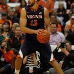 Virginia's Anthony Gill looks to pass the ball in the second half of Monday's game against Syracuse in Syracuse, N.Y. Virginia won 59-47.