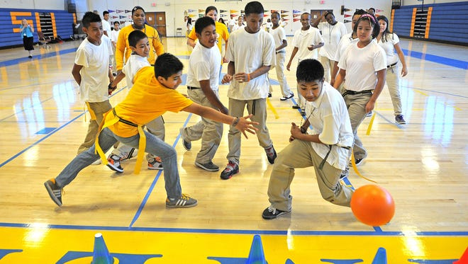 """Cameron College Prep students participate in a game of """"cone handball"""" as part of their physical education program at Cameron Middle School, a LEAD school. LEAD is looking to expand its network in Nashville."""