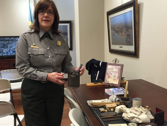 Ranger Deborah Austin shows items included in a hands-on