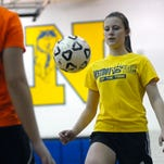 Allie Wight practices knee bounces Monday, Mar 23, during soccer practice at Port Huron Northern.