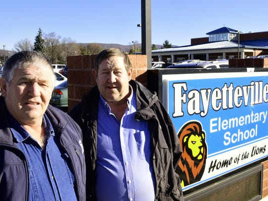 Stanley Helman, left, and his brother, Robert, both started serving on the Chambersburg Area School board in the mid-90s. The men met reporters Wednesday, Jan. 6, 2016 at Fayetteville Elementary School.