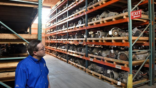 PAM's Auto Chief Financial Officer Pat Huesers talks about how parts are stored Thursday, April 14, at the St. Cloud-based business. PAM's Auto will be hosting the Upper Midwest Auto Recyclers Convention and Tradeshow.