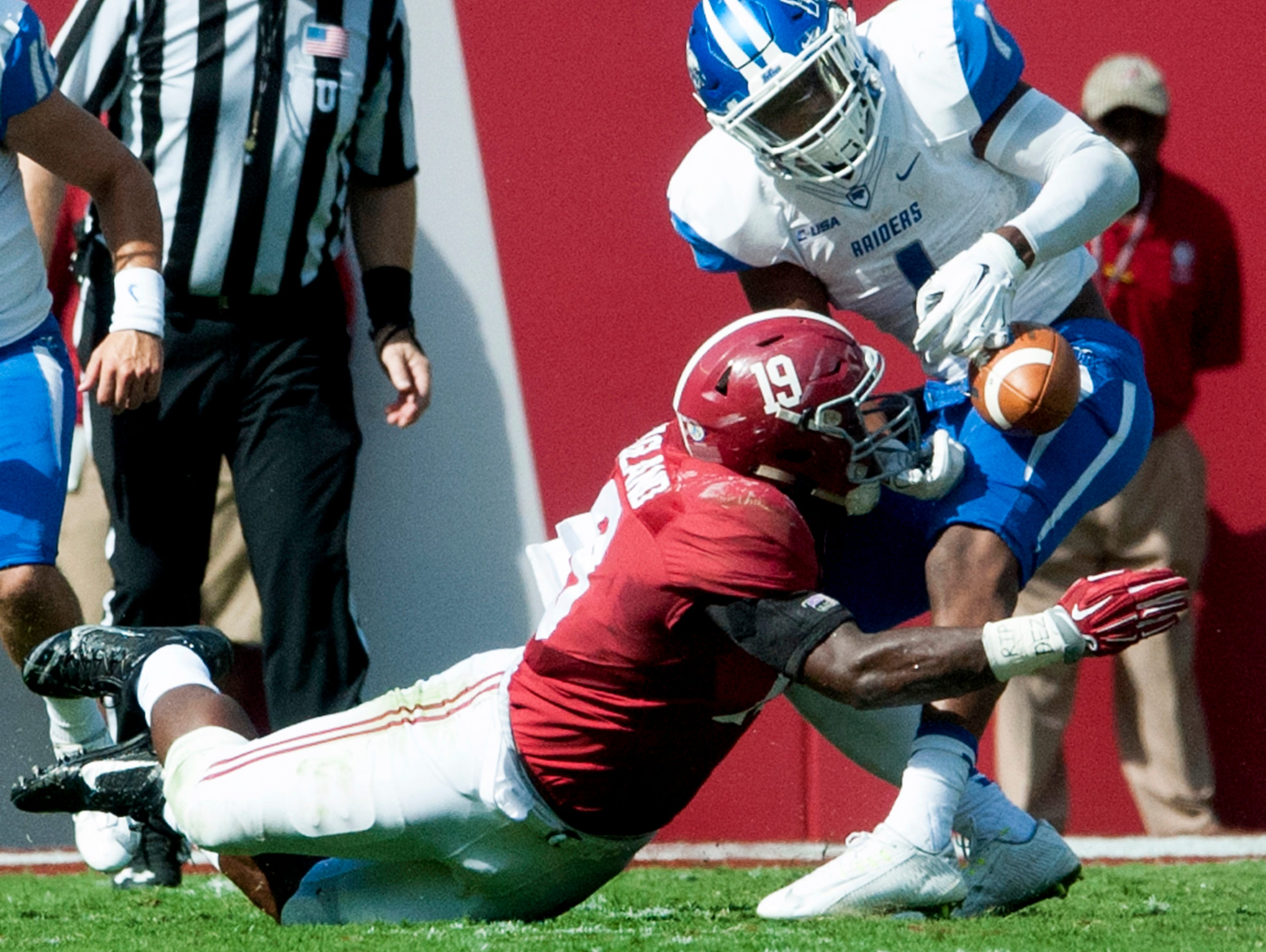 Alabama linebacker Reggie Ragland (19) causes a fumble by Middle Tennessee's Shane Tucker (1) during the first half of an NCAA college football game, in Tuscaloosa, Ala., on Saturday, Sept. 12, 2015. (Mickey Welsh/The Montgomery Advertiser via AP) NO SALES; MANDATORY CREDIT