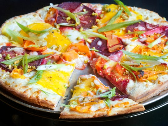 The Ciao Ristorante's carrot and beef pizza is made from coating a traditional pizza dough with an Alfredo cream sauce then topping it with Italian seasonings, mozzerela cheese, carrot and beet slices, pistachio pieces and green onion.June 27, 2018