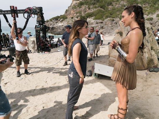 """Director Patty Jenkinks (left) and Gal Gadot on the set of """"Wonder Woman,"""" a Warner Bros. Pictures release."""