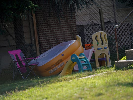 An inflatable swimming pool rest on top of play sets