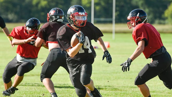 Rocori running back Brock Leither breaks away on a run during practice Tuesday, Aug. 22, in Cold Spring.