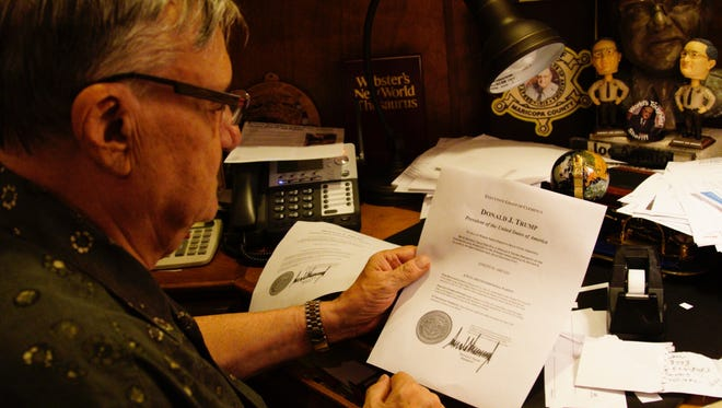 Former Maricopa County Sheriff Joe Arpaio reads his official pardon letter from President Donald Trump on Aug. 25, 2017.