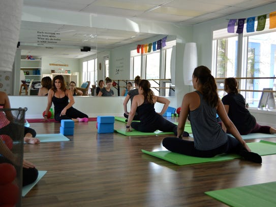 Julie Wender leads a barre fitness class at her studio,