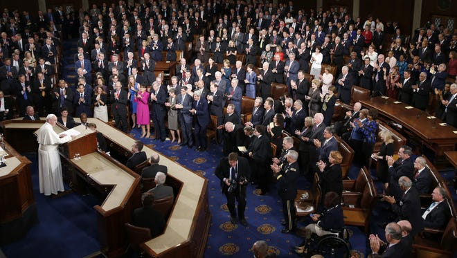 Pope Francis addresses Congress in the House chamber of the U.S. Capitol in Washington. He made history Thursday, Sept. 24, 2015, as the first pontiff to do so.
