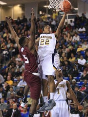 Sanford's Anthony Mosley (22) puts up a shot in front of Concord's DeShawn Lowman in the first half of a DIAA state tournament game in 2012 at the Bob Carpenter Center. Mosley put together a successful career as a guard at Delaware on the same court after high school.