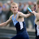 Luke Sampson of Little Chute reaches back to teammate Parker Wyngaard for the baton during the first exchange of the 3,200-meter relay at the WIAA Division 2 track and field sectional Friday in Little Chute.