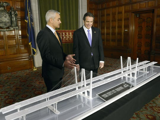 Gov. Andrew Cuomo, right, and Brian Conybeare,  special advisor on the Tappan Zee Bridge project, study a model of the replacement bridge in 2013.
