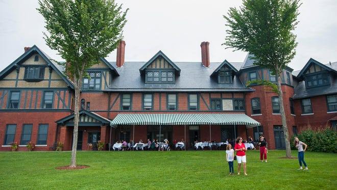 Diners enjoy the patio and the grounds at The Inn at Shelburne Farms in Shelburne. Seen on Tuesday, August 22, 2017.