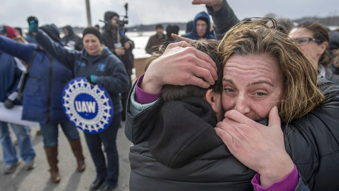 Amy Drennen, right, of Lordstown, Ohio, an employee at General Motors for 12 years, receives a hug from Pam Clark, as people gather in front of the General Motors assembly plant, Wednesday, March 6, 2019, in Lordstown, Ohio. Wednesday is the last day of the plant's Chevrolet Cruze production, a move that will eliminate nearly 1,700 hourly jobs and idle the plant. (Steph Chambers/Pittsburgh Post-Gazette via AP)