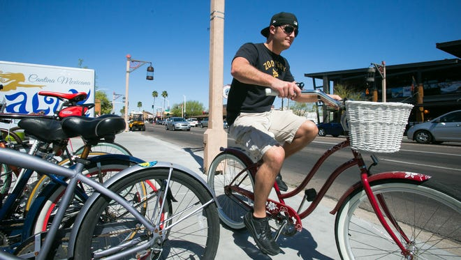 Randy Winowiecki rides his bike on a trip from the Salty Senorita to Scottsdale Stadium.
