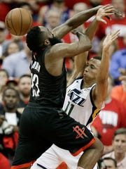 Rockets guard James Harden, left, is fouled by Jazz guard Dante Exum in Game 2 on May 2, 2018, in Houston.
