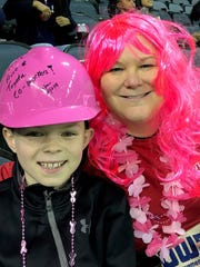 BigWigs - Millie Marshall, President of Toyota and a Komen BigWigs participant was at the Thunderbolts game last Friday night decked out in her pink wig and selling half-pot tickets. She is pictured with Luke Johnston, the son of Brad and Karen Johnston.  Karen is the Manager of External Affairs at Toyota.
