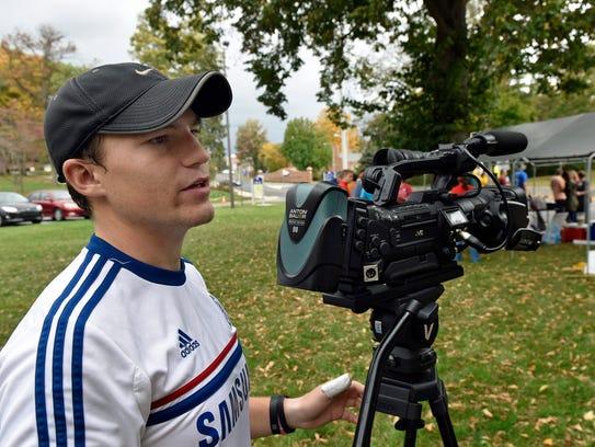 SUTV cameraman Jake Gillespie gets his gear ready to