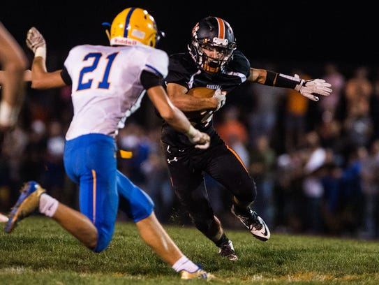 Palmyra's Eddie Cannon tries to find a way past Middletown's