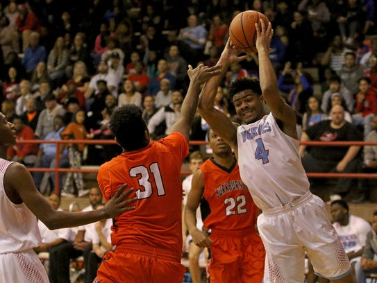 Hirschi's Javen Banks grabs the rebound in the game