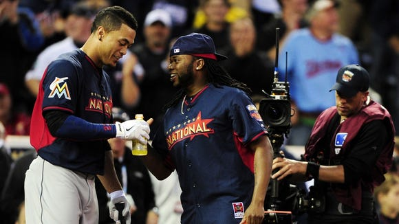 The Marlins' Giancarlo Stanton and the Reds' Johnny Cueto joke around during last year's Home Run Derby in Minneapolis. Note: The injured Stanton has been replaced in the All-Star Game starting lineup by the Pirates' Andrew McCutchen.